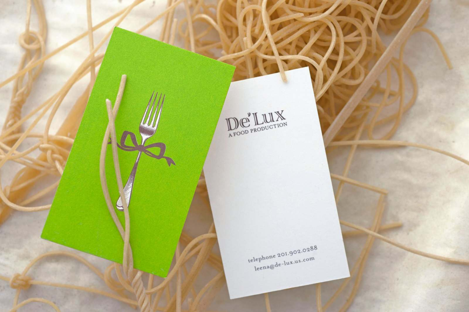 Client logos for business cards randy howard and delux catering called for a playful solution a hybrid screwdriver pencil intended to draw attention to his unusual set of capacities delux offers high end colourmoves